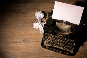 http://www.dreamstime.com/royalty-free-stock-photos-vintage-typewriter-blank-sheet-paper-image35272668
