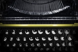 Old yellow typewriter in shadow